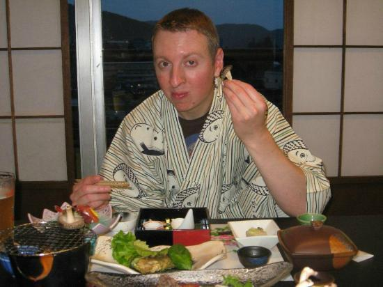 Ryokan Biyunoyado : My husband eating one park of the multi-course meal. It was light outside when we started eating