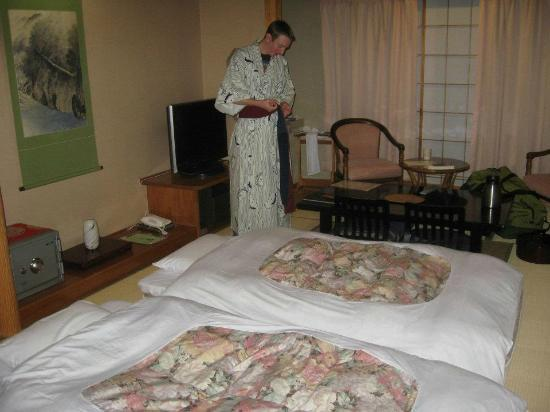 Ryokan Biyunoyado: My husband wearing the hotel yukata. The beds were nice and comfy!