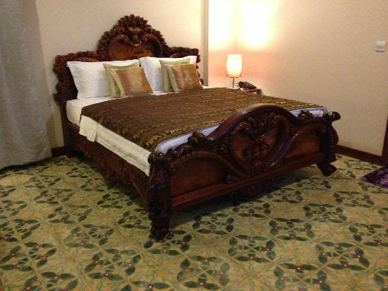 lux guest house the spacious room features a beautiful bed frame made from rare canbodia - Beautiful Bed Frames