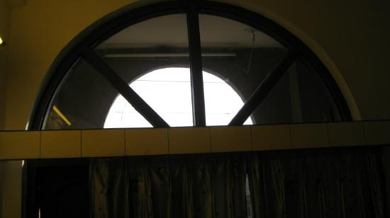 Regal Hotel: W2: Window with no curtain & tube light shining outside at night