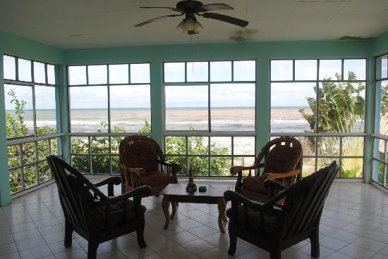 Ensuenos Del Mar S.A.: Screened porch overlooking the sea