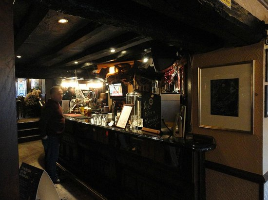 The Victoria Pub: Inside view showing central bar area