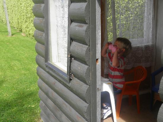 Queens Park Motels: Our son enjoying the playhouse at the back of the section