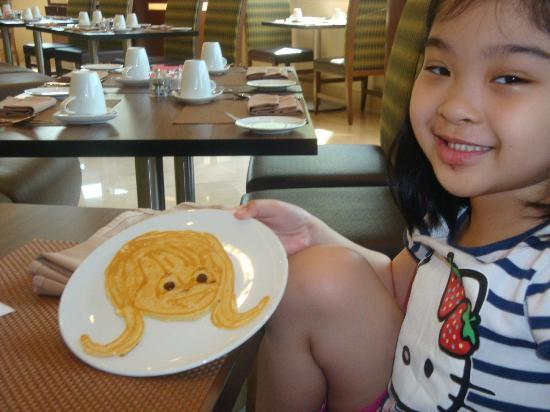Crowne Plaza Doha - The Business Park: My daughter enjoying the Princess pancake that specially cooked for her by the chef..