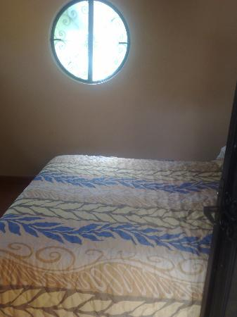Luz En Yucatan: Moon shaped Window in Bedroom