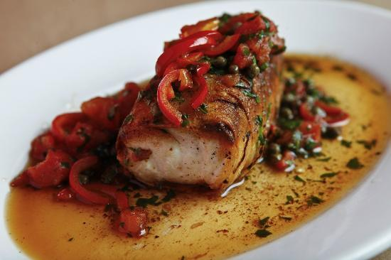 Isa: Potato wrapped Seabass with capers, fresno pprs, parsley, tomato confit, brown butter & ...