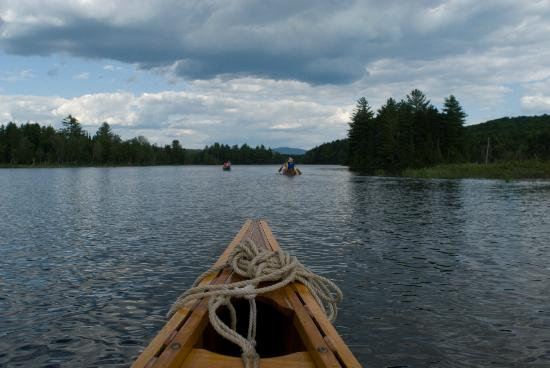 Mahoosuc Guide Service: Last Canoe in the train on Umbagog Lake - Carol Savage