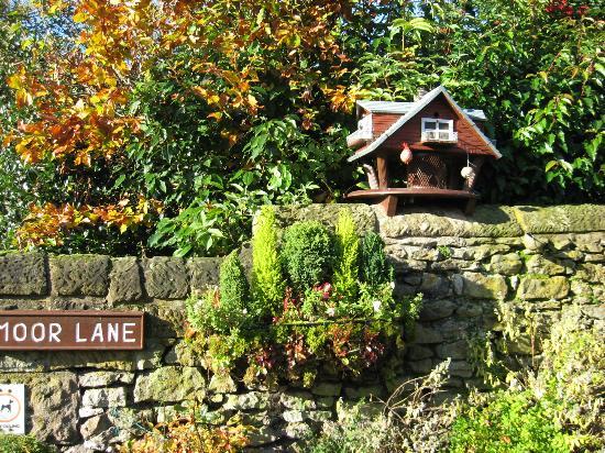 The Farmyard Inn: A neighbouring house and bird table!