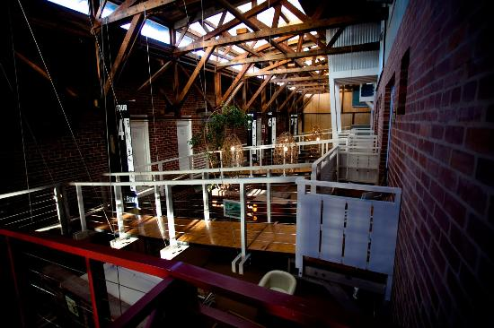 The Lofts Boutique Hotel: Interior of the Boatshed. Suites are across the walkways to the right.