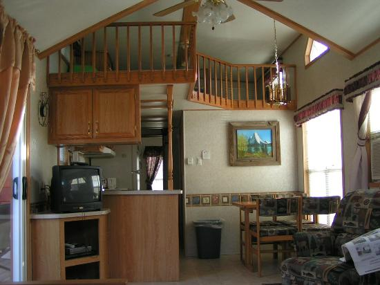 Creekside Country Resort: Pictured is the kitchen and loft area in one of our cabins. Loft hasTV, & bean bag chair, for ki