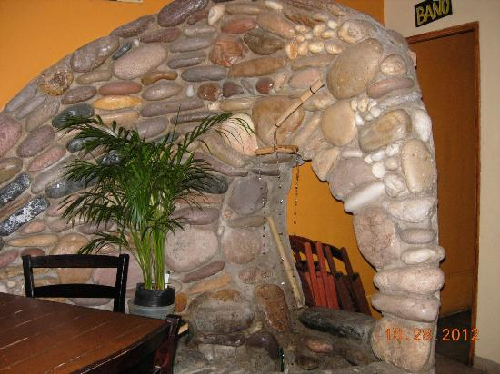 Looney Bean Coffee Shop: waterfall rock arch inside the shop
