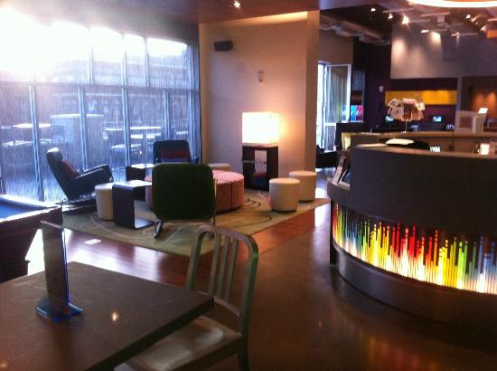 Aloft Asheville Downtown: Continuation of the public lounge areas - the circular area to the right is a reception area.