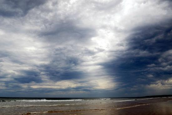 Point Impossible Surf Beach: A storm on the beach: atmospheric summer skies at Point Impossible, Torquay, Victoria