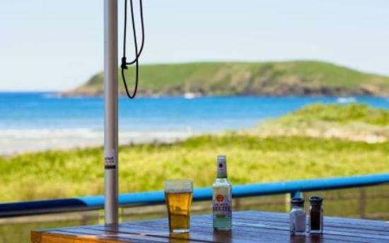Surf Club Restaurant & Bar: sitting under an umbrella on our northern deck