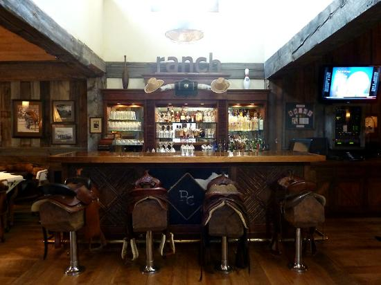 The Ranch at Rock Creek: Saloon bar with cool horse saddle seats