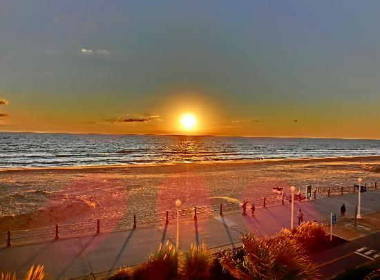 Holiday Inn Express Hotel & Suites Virginia Beach Oceanfront: Sunset from 3rd floor room ...