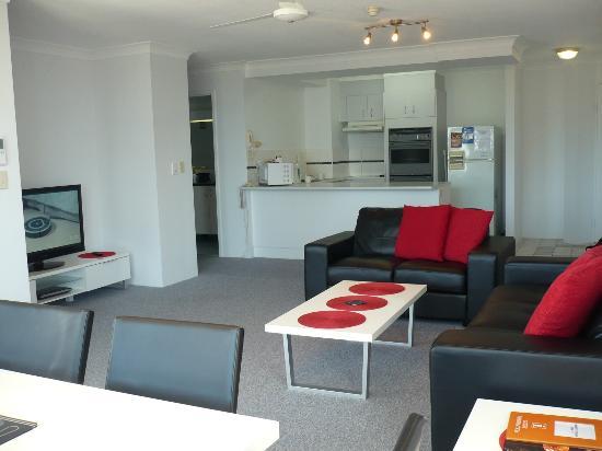 Surfers Plaza Resort: Lounge , & open plan kitchen.