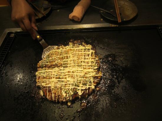 Tsukishima Monjya Street: Okonomiyaki deftly served up.