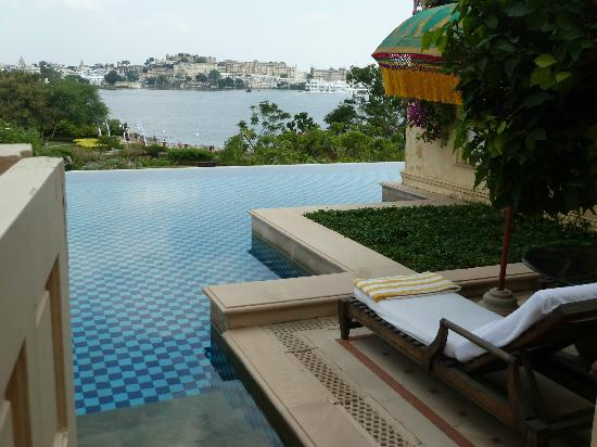 The Oberoi Udaivilas: Pool from our sitting area - 2 loungers and table