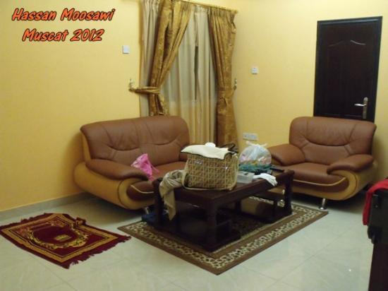 Tiger Home Hotel Apartments: Family Sitting / Small & contain Queen bed in a corner separated with only thin curtain strings