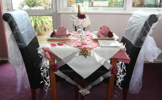 The Swiss Cottage Shanklin: Dining Room Table set for a Celebration