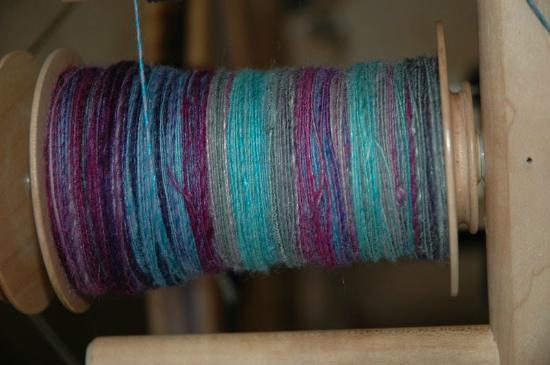 Paradise Fibers, Inc: first project on my Revolution wheel