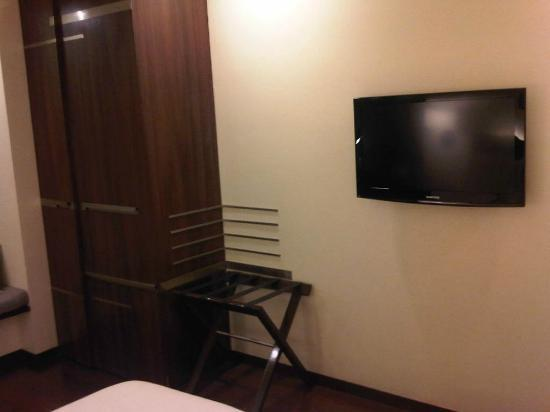 Marasa Sarovar Portico, Rajkot: TV panel & cupboard with a fridge