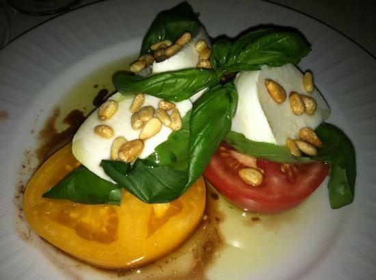Piero's Italian Cuisine: Caprese salad with heirloom tomatoes, buffalo Mozzarella, basil and pine nuts.