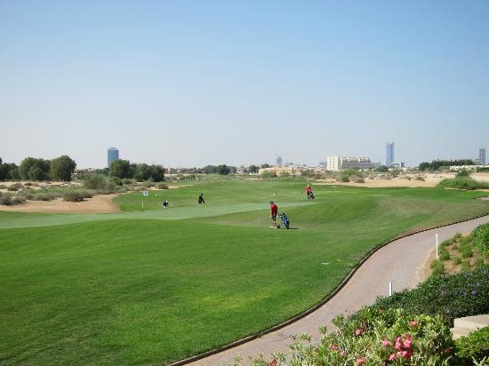 Arabian Ranches Golf Club Hotel: Part of the course, from the dining terrace