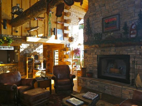 White River Lodge: Their massive fireplace centers the lodge's main room full of interesting decor.
