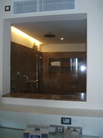 Beloved Playa Mujeres: Window looking into the shower from the room