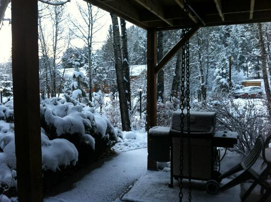 Streamside on Fall River: our front porch after snow