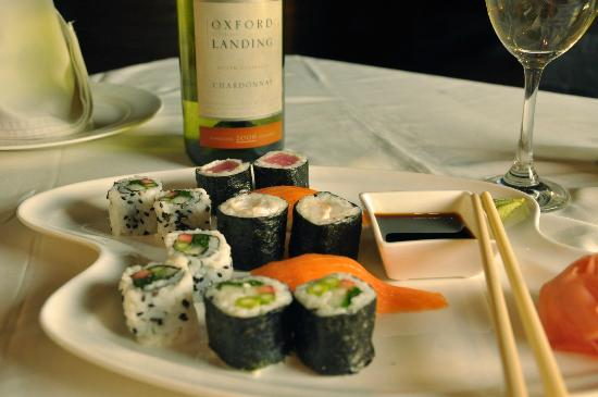 Dine Esty : Assorted Sushi Plater with choice of wine.