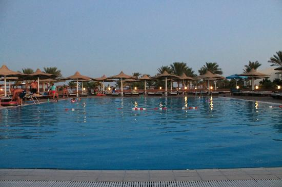 Coral Sea Holiday Village: Main pool at dusk