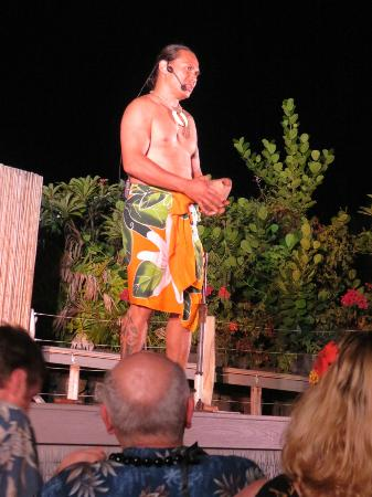 Island Breeze Luau: This guy is hilarious...opening a coconut...
