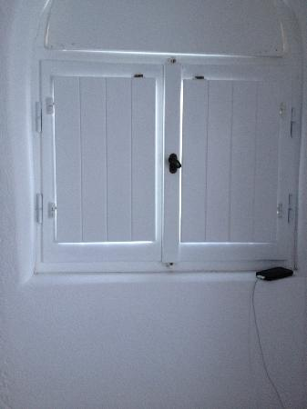 Porto Fira Suites : Our windows were like cottage style shutters. really pretty, but the bugs do come in!