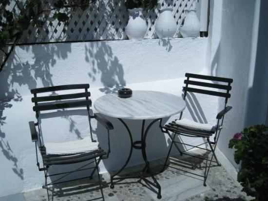 Porto Fira Suites: our table and chairs near our door