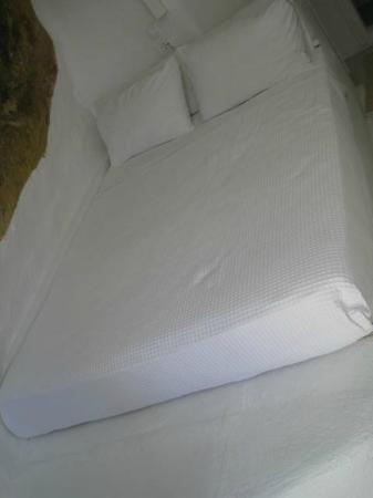 Porto Fira Suites: The bed. A mattress on a concrete slab, but clean and good enough for us