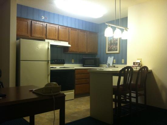 Residence Inn Raleigh-Durham Airport/Morrisville: 1980s kitchen has dishes, utensils, pots and pans.