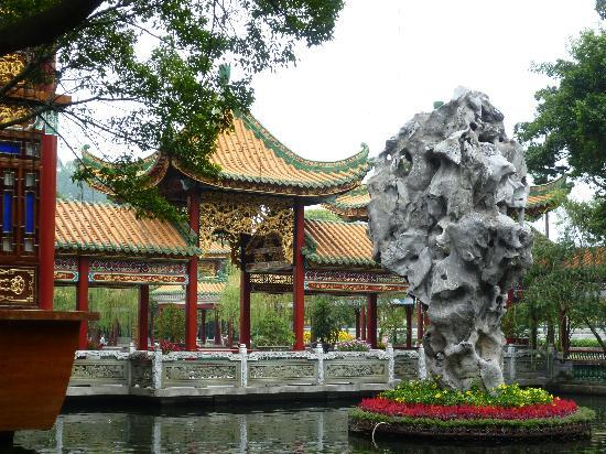 Xi'an, China: Beautiful Classic Chinese Building with Golden Fish Pond and Flower Garden