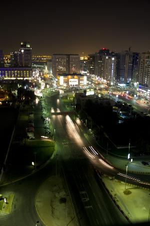 Hala Arjaan by Rotana Abu Dhabi: Nighttime view of the city from our balcony