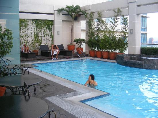 Swimming pool picture of city garden hotel makati for Garden city swimming pool