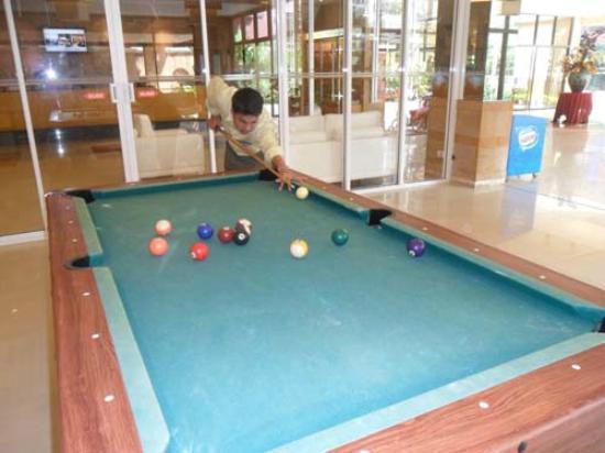 Bella Villa Prima Hotel: my hubby playing pool!