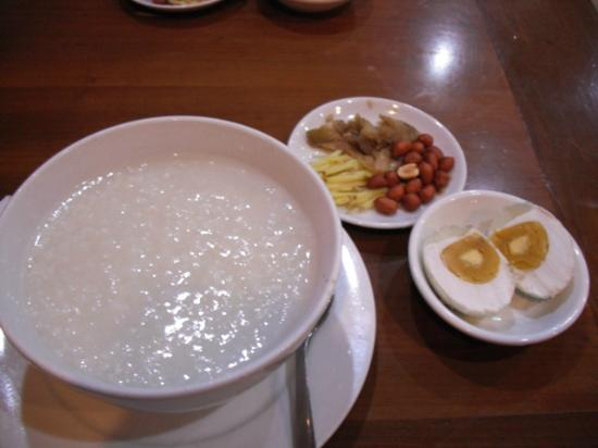 A25 Hotel: Vietnamese porridge with salted egg & pickles near hotel
