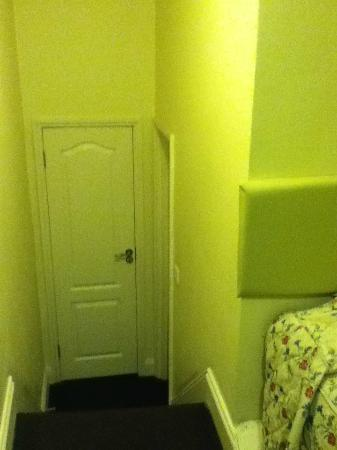 Grantly Hotel: View when standing bedside the head of the bed. Door ahead is bathroom, one on right is entrance