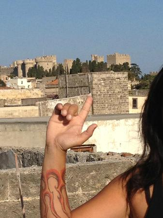 Spot Hotel: hmm..I think that may be the Palace of the Grand Masters that I'm pointing at. View from Roof Ga