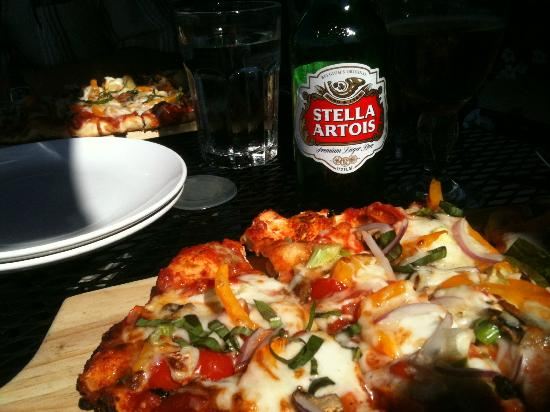 Pier Restaurant: Brick Oven Pizza served on a wooden board