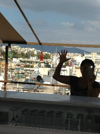 Acropolis Ami Boutique Hotel: view of the city behind me as I shoot into the mirror in front of me - roof garden