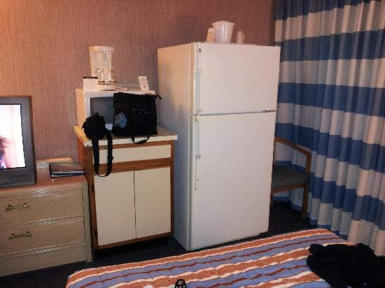 Hotel Blue: a full size kitchen fridge at the foot of the bed. normally you would expect a mini fridge. i st