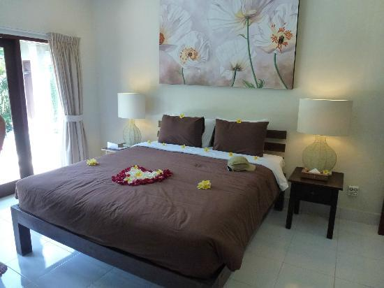 Umah Watu Villas: The Master Suite with double doors looking out to the pool